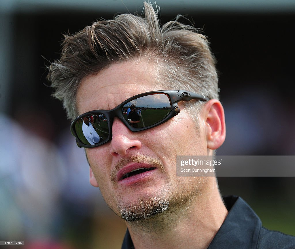 General Manager Thomas Dimitroff of the Atlanta Falcons watches practice against the Cincinnati Bengals at the Atlanta Falcons Training Complex on August 6 2013 in Flowery Branch, Georgia.