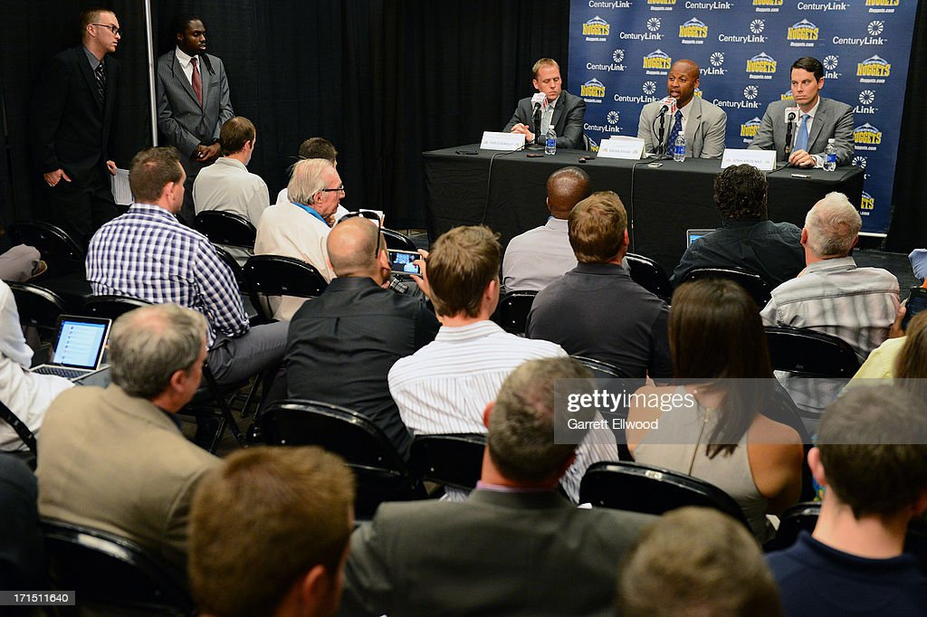 General Manager Tim Connnelly, Head Coach Brian Shaw, and President Josh Kroenke of the Denver Nuggets answer questions from the media during the press conference on June 25, 2013 at the Pepsi Center in Denver, Colorado.