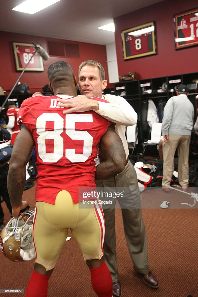 General Manager Trent Baalke of the San Francisco 49ers congratulates Vernon Davis #85 in the locker room following the game against the Green Bay Packers at Candlestick Park on January 12, 2012 in San Francisco, California. The 49ers defeated the Packers 45-31.