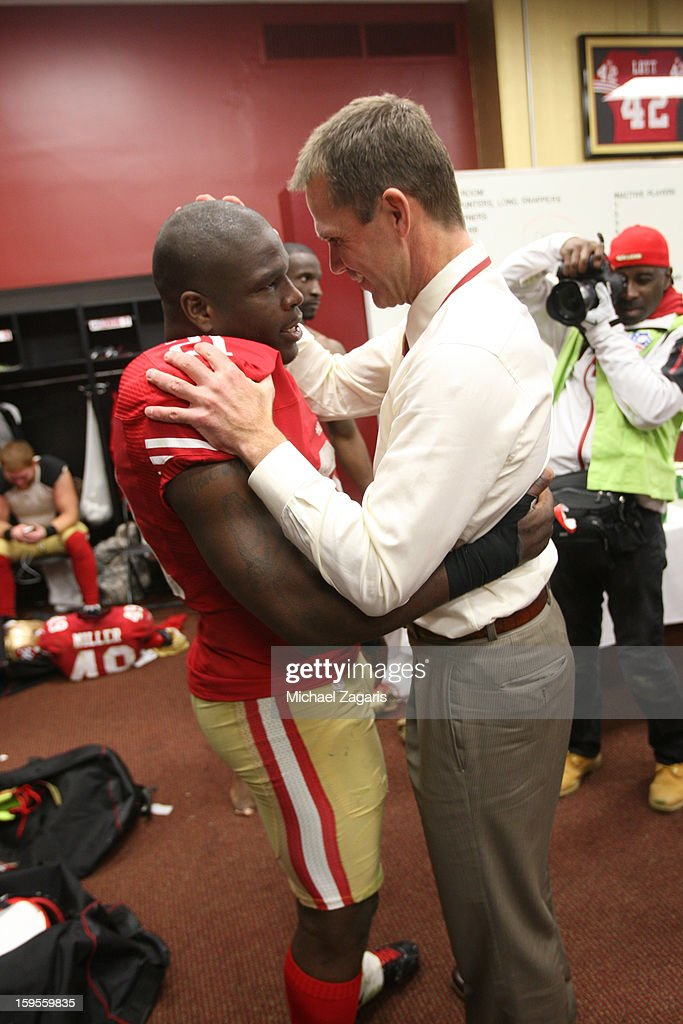 General Manager Trent Baalke of the San Francisco 49ers congratulates Frank Gore #21 in the locker room following the game against the Green Bay Packers at Candlestick Park on January 12, 2012 in San Francisco, California. The 49ers defeated the Packers 45-31.