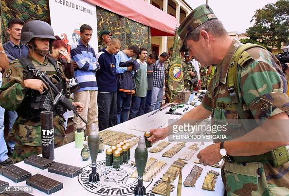 General Mario Montoya commander of the Colombian Army observes military material seized from the Revolutionary Armed Forces of Colombia 08 April 2002...