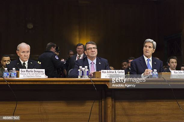 General Martin Dempsey Chairman of the Joint Chiefs of Staff Secretary of State John Kerry and Secretary of Defense Ashton Carter listen to Senators...