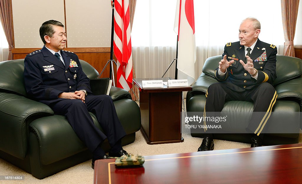 General Martin Dempsey (R), chairman of the US Joint Chiefs of Staff, chats with his Japanese counterpart Shigeru Iwasaki during their talks at the Defence Ministry in Tokyo on April 26, 2013. The US's top military officer said in Japan on April 25 that his troops were ready to act if North Korea turned its increasingly bellicose rhetoric into action. AFP PHOTO / Toru YAMANAKA
