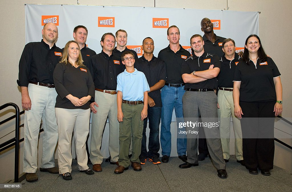 General Mills guests and employees pose for a photo with Gold medal winning decathlete Bryan Clay, NBA star Kevin Garnett, Indianapolis Colts quarterback <a gi-track='captionPersonalityLinkClicked' href=/galleries/search?phrase=Peyton+Manning&family=editorial&specificpeople=184524 ng-click='$event.stopPropagation()'>Peyton Manning</a>, triathlete Hunter Kemper and sports nutritionist Dr. John Ivy during a press conference at Conseco Fieldhouse on July 23, 2009 in Indianapolis, Indiana.