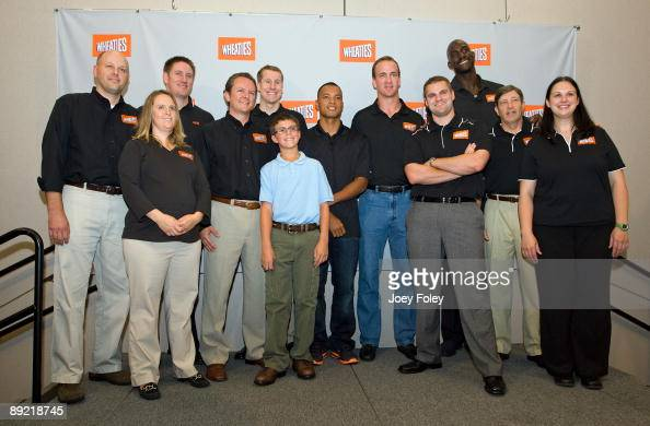 General Mills guests and employees pose for a photo with Gold medal winning decathlete Bryan Clay NBA star Kevin Garnett Indianapolis Colts...
