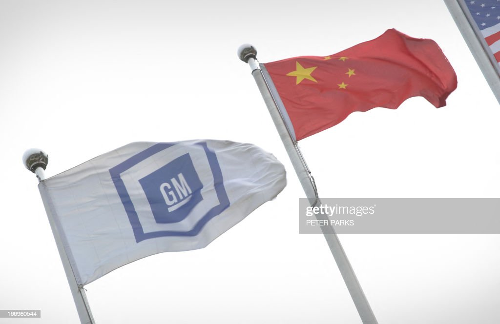 General Motors and China flags fly at its China headquarters in Shanghai on April 19 2013 GM will launch 17 new or updated models in China this year...