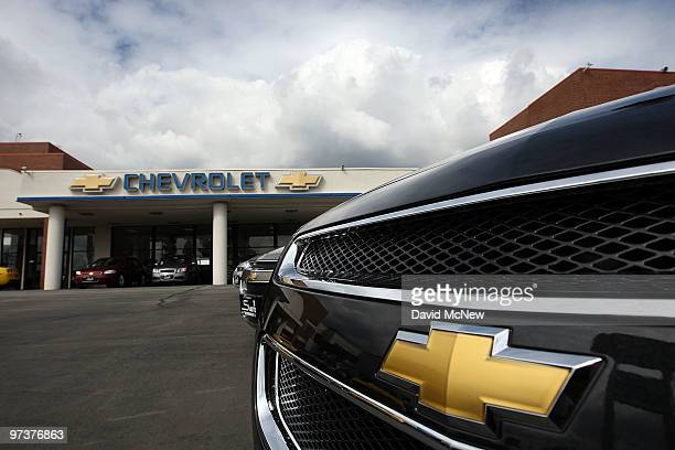 General Motors cars are displayed at the Sierra Chevrolet auto dealership as storm clouds build in the distance on March 2 2010 in Monrovia...