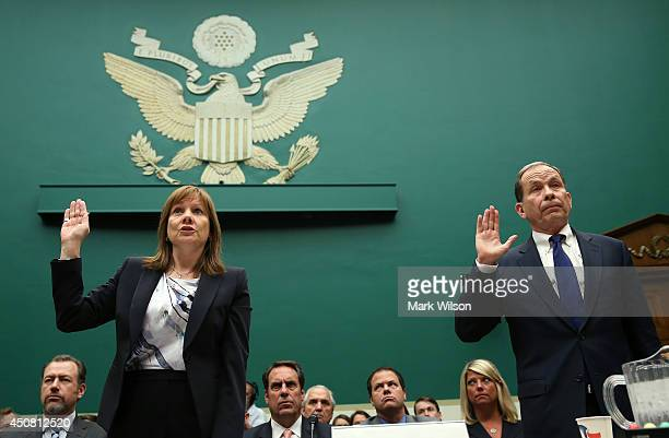 General Motors CEO Mary Barra and Anton Valukas head of GM's internal recall investigations are sworn in before testifying during a House Energy and...