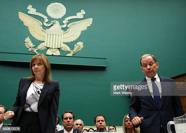 General Motors CEO Mary Barra and Anton Valukas head of GM's internal recall investigation stand at the witness table during a House Energy and...