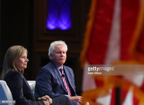 General Motors CEO Mary Barra and General Electric CEO Jeffrey Immelt participate in a discussion moderated by Commerce Secretary Wilbur Ross during...