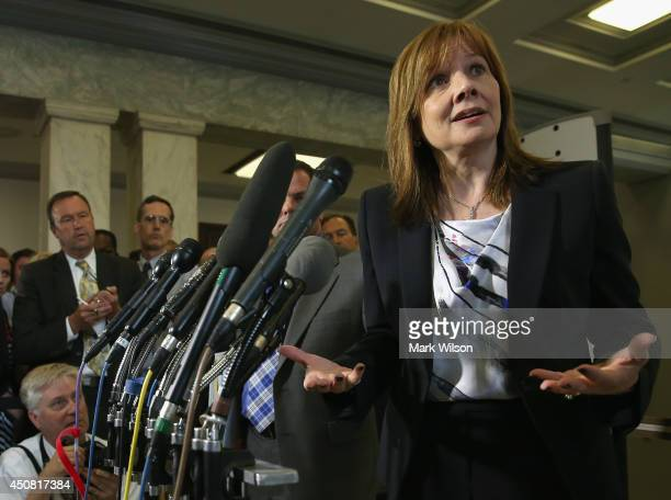 General Motors CEO Mary Barra talks to the media after appearing before the House Energy and Commerce Committee on Capitol Hill on June 18 2014 in...