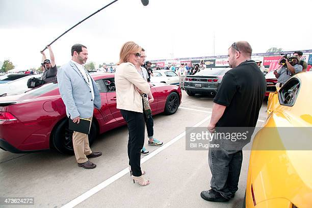 General Motors CEO Mary Barra talks with Camaro owners on Detroit's Belle Isle before GM officially reveals the new 2016 Chevrolet Camaro May 16 2015...