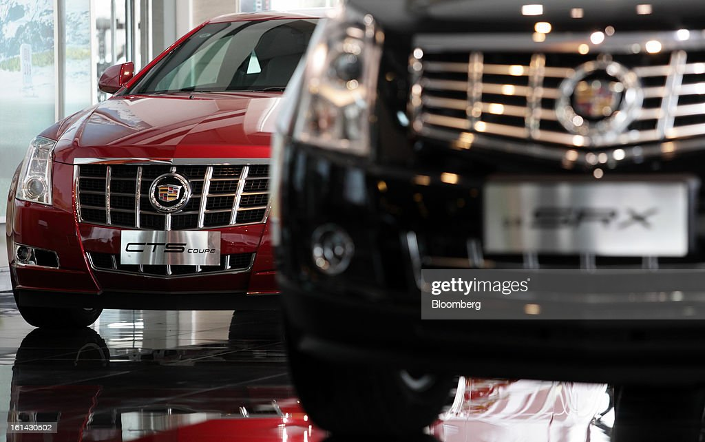 General Motors Co. Cadillac CTS, left, and SRX vehicles are displayed at a dealership in Shanghai, China, on Friday, Feb. 8, 2013. China's services industries grew at the fastest pace since August as gains in retailing and construction aid government efforts to drive a recovery in the world's second-biggest economy. Photographer: Tomohiro Ohsumi/Bloomberg via Getty Images