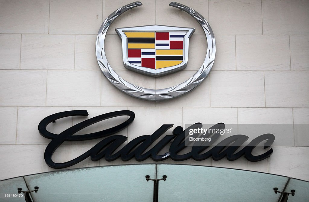 General Motors Co. Cadillac signage is displayed outside a dealership in Shanghai, China, on Friday, Feb. 8, 2013. China's services industries grew at the fastest pace since August as gains in retailing and construction aid government efforts to drive a recovery in the world's second-biggest economy. Photographer: Tomohiro Ohsumi/Bloomberg via Getty Images