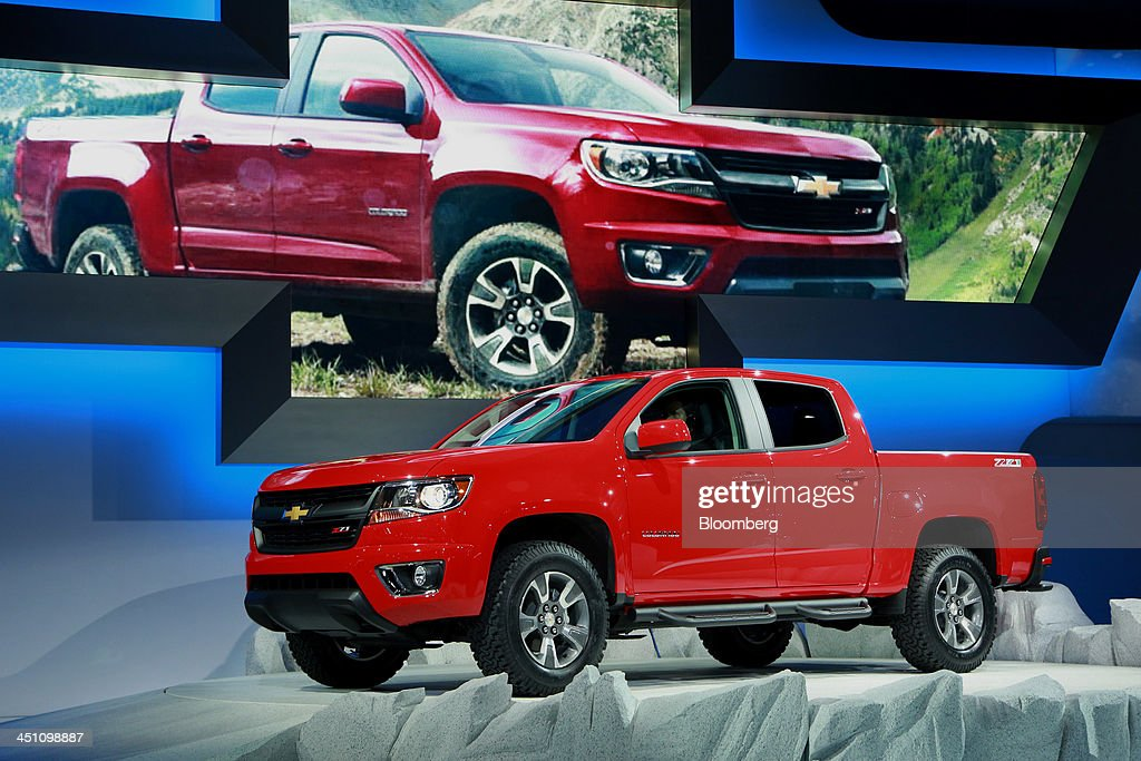 A General Motors Co. Chevrolet Z71 Colorado truck stands on display during the LA Auto Show in Los Angeles, California, U.S., on Wednesday, Nov. 20, 2013. General Motors Co. (GM) said its redesigned Chevrolet Colorado mid-sized pickup has greater towing capacity than Toyota Motor Corp.'s Tacoma as the automaker returns to the segment to challenge the market leader. Photographer: Jonathan Alcorn/Bloomberg via Getty Images