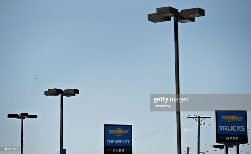 A General Motors Co. Chevy sign stands outside Webb ...