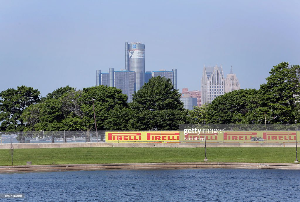 General Motors Co. (GM) headquarters stands in the distance prior to the introduction of the 2014 Chevrolet Malibu at the Belle Isle Grand Prix racetrack in Detroit, Michigan, U.S., on Friday, May 31, 2013. General Motors Co., after failing to gain sales with its redesigned Chevrolet Malibu last year, said it's developed an updated version of the mid-size sedan with a sportier front end, roomier back seat and better fuel efficiency. Photographer: Fabrizio Costantini/Bloomberg via Getty Images