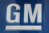 General Motors Co logo hangs above a Chevrolet dealership on April 7 2010 in Chicago Illinois A spokesperson for General Motors said today the...