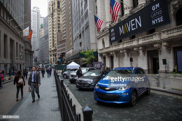 General Motors Co Maven carsharing service vehicles sit parked in front of the New York Stock Exchange in New York US on Monday May 15 2017 US stocks...