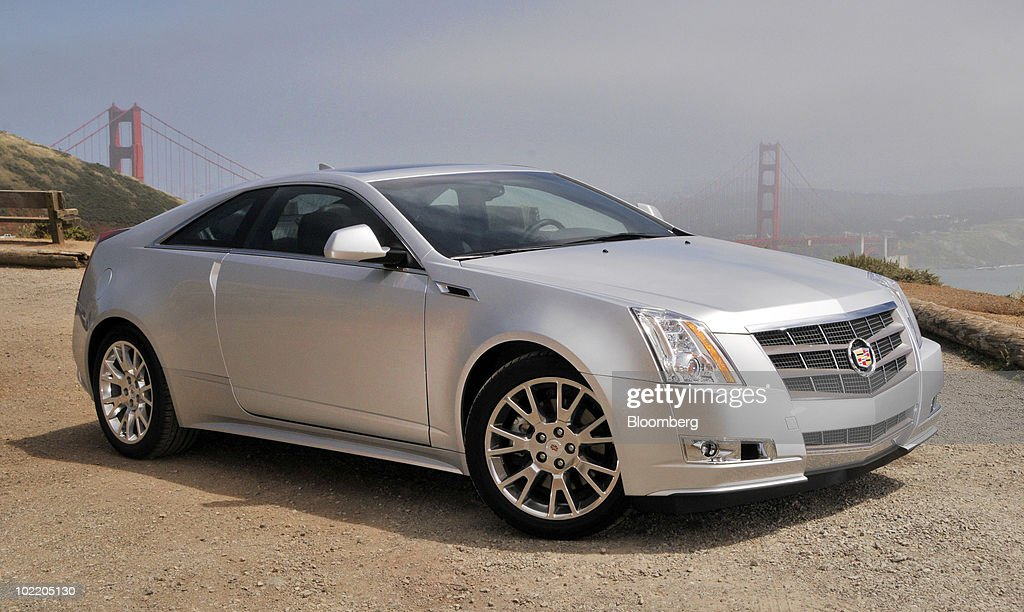 General Motors Co.'s 2011 Cadillac CTS Coupe is displayed for a photo with the Golden Gate Bridge behind it in the Marin Headlands in Sausalito, California, U.S., on Monday, June 14, 2010. GM is making a push to revive the Cadillac brand which has fading appeal, aging customers and trouble persuading buyers it's worth paying a premium. Photographer: Mark Elias/Bloomberg via Getty Images
