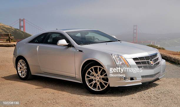 General Motors Co's 2011 Cadillac CTS Coupe is displayed for a photo with the Golden Gate Bridge behind it in the Marin Headlands in Sausalito...