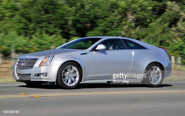 General Motors Co's 2011 Cadillac CTS Coupe is test driven during a media preview in Yountville California US on June 15 2010 GM is making a push to...