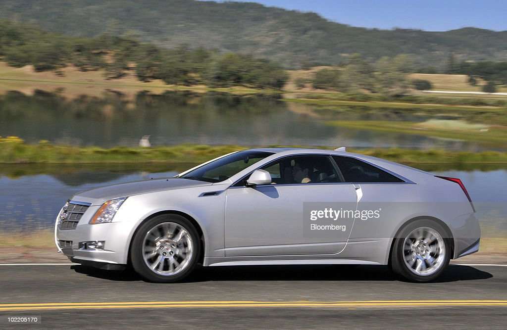 General Motors Co.'s 2011 Cadillac CTS Coupe is test driven during a media preview in Yountville, California, U.S., on June 15, 2010. GM is making a push to revive the Cadillac brand which has fading appeal, aging customers and trouble persuading buyers it's worth paying a premium. Photographer: Mark Elias/Bloomberg via Getty Images