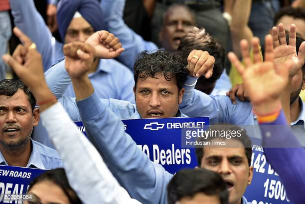 General Motors India's dealers members of Federation of Automobiles dealers Associations along with their employees protest against Chevrolet after...