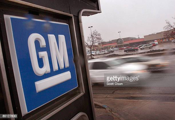 General Motors logo hangs at the entrance to a Chevrolet dealership February 26 2009 in Park Ridge Illinois General Motors Corp the maker of...