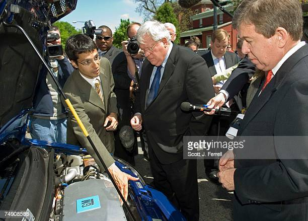 General Motors representative shows House Speaker J Dennis Hastert RIll and House Majority Whip Roy Blunt RMo under the hood of a General Motors...