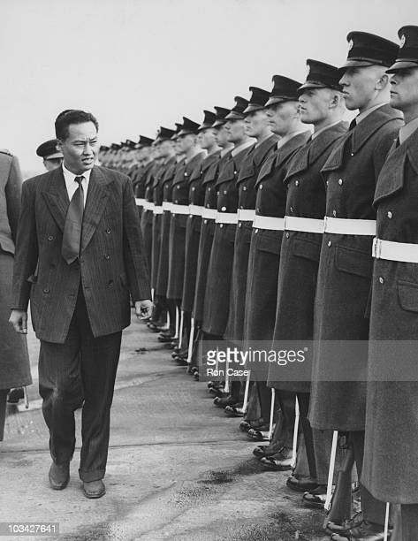 General Ne Win of Burma inspects an RAF guard on his arrival at Heathrow Airport in London England on October 17 1952