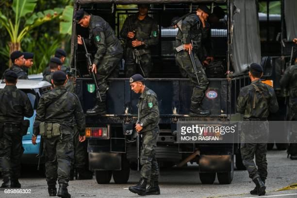 General Operations Force policemen arrive to provide security during the court appearance of Indonesian national Siti Aisyah and Vietnamese national...
