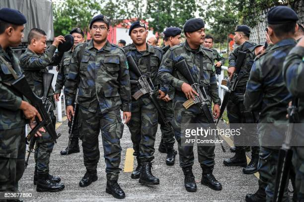 General Operations Force policemen arrive to provide security during the court appearance of Indonesian national Aisyah and Vietnamese national Doan...