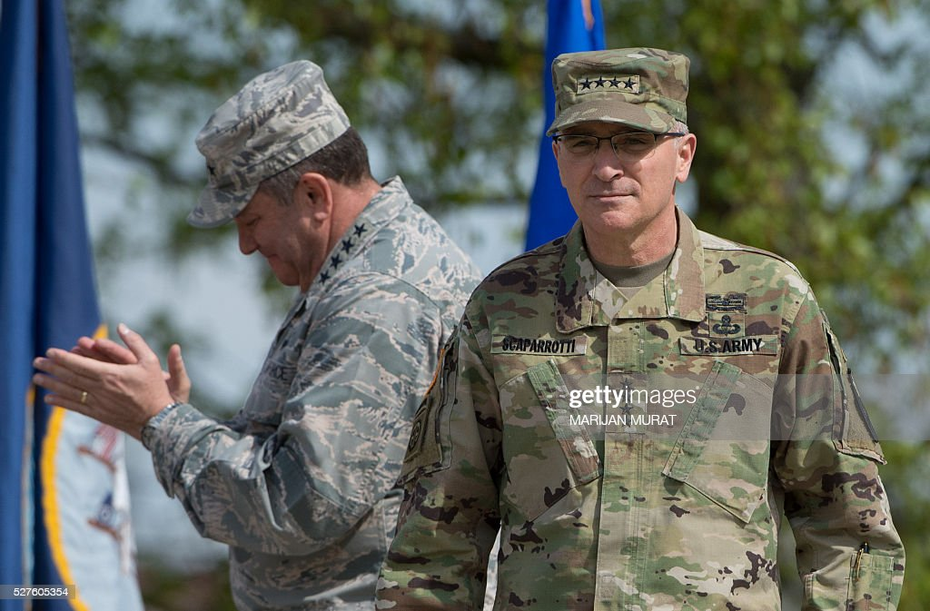 US General Philip Breedlove (L) applauds as he stands next to US General Curtis Scaparrotti during a ceremony on May 3, 2016 at the Patch Barracks in Stuttgart, southern Germany. The ceremony took place at the barracks as US General Curtis Scaparrotti was introduced as Commander of the US European Command, taking over from US General Philip Breedlove. / AFP / dpa / Marijan Murat / Germany OUT