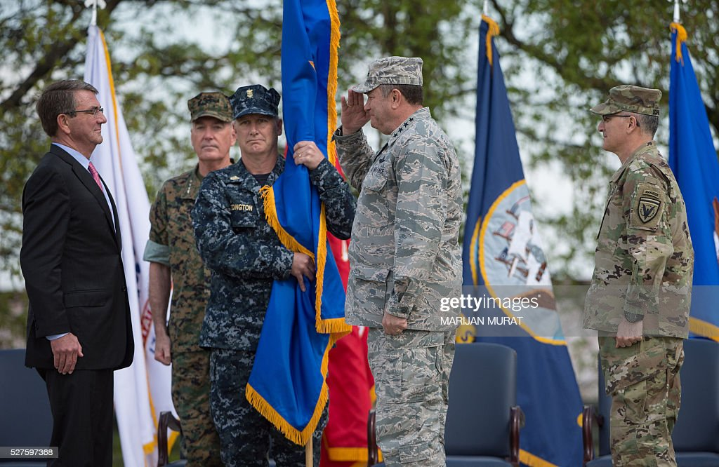 US General Philip Breedlove (2nd R) salutes in front of US Defence Secretary Ashton Carter (L) as US General Joseph Dunford (2nd L), Command Master Chief Crispian Addington (3rd L) and US General Curtis Scaparrotti (R) look on during a ceremony on May 3, 2016 at the Patch Barracks in Stuttgart, southern Germany. Carter attended a ceremony as US General Curtis Scaparrotti was introduced as Commander of the US European Command, taking over from US General Philip Breedlove. / AFP / dpa / Marijan Murat / Germany OUT