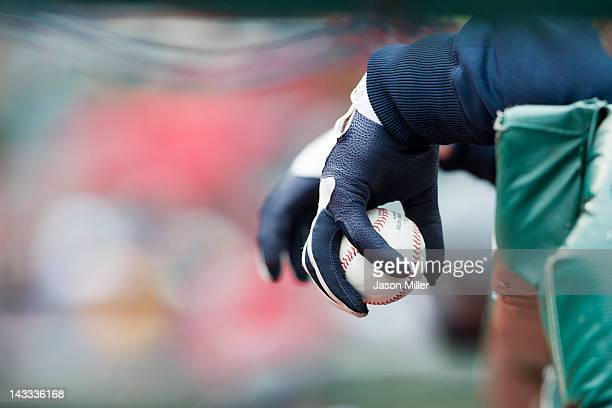 A general photo of a gloved hand holding a ball over the dugout fence during the second inning of the game between the Cleveland Indians and the...
