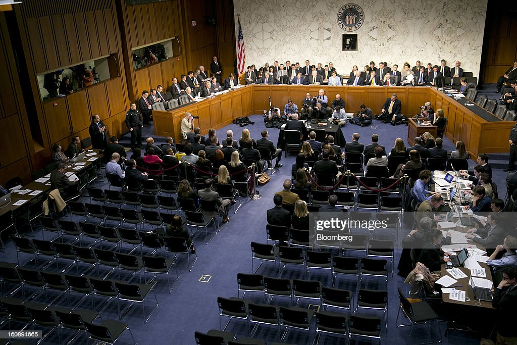 General public chairs sit empty after the room was cleared because of protestors during a Senate Select Intelligence Committee nomination hearing of John Brennan, nominee for director of the Central Intelligence Agency (CIA) and White House chief counterterrorism adviser, top center, in Washington, D.C., U.S., on Thursday, Feb. 7, 2013. Protesters sought to set the tone at the confirmation hearing of Brennan, President Barack Obama's nominee to lead the CIA, disrupting proceedings today before Brennan even spoke. Photographer: Andrew Harrer/Bloomberg via Getty Images