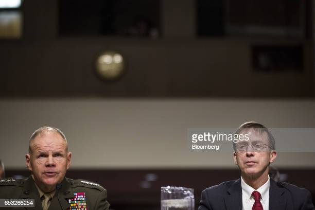 General Robert Neller Commandant of the US Marine Corps left testifies as Sean Stackley acting Secretary of the Navy listens during a Senate...
