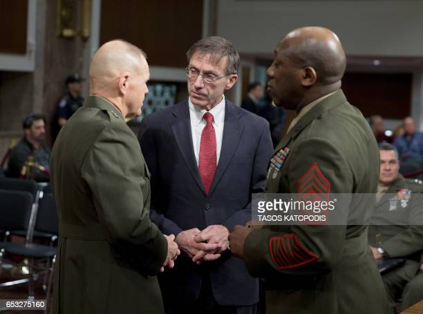 General Robert Neller Secretary Sean Stackley and SGT Major MC Green are seen before the start of the Senate Armed Services Committee on information...