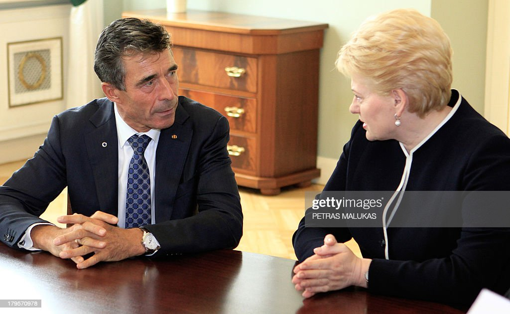 General Secretary Anders Fogh Rasmussen (L) and Lithuania's President Dalia Grybauskaite talk during a meeting in Vilnius on September 5, 2013.