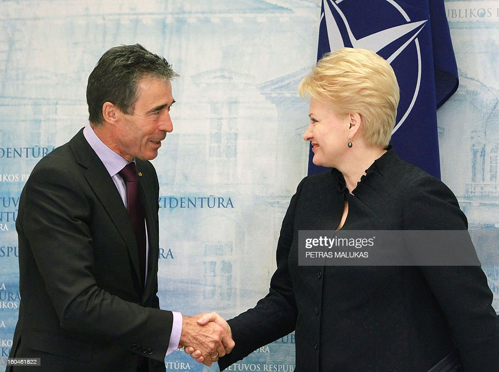 General Secretary Anders Fogh Rasmussen shakes hands with Lithuania's President Dalia Grybauskaite after their joint press conference in Vilnius on February 1, 2013. Rasmussen said today he saw no role for the Western defence alliance in Mali, but hailed allies who moved to assist the French-led operation during a brief visit to Lithuania's capital Vilnius.