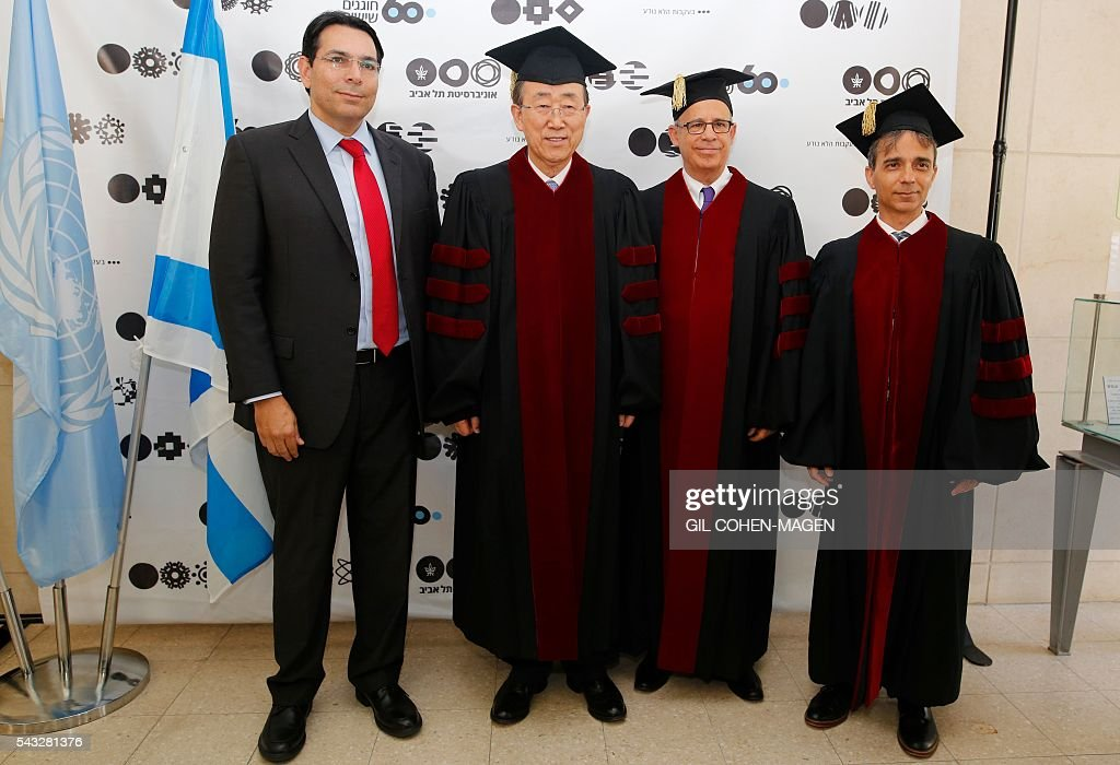UN general secretary Ban Ki-Moon (2-L) poses for a picture with Israeli ambassador to the United Nations Danny Danon (L), president of the Tel Aviv university Joseph Klafter (2-R), and the rector Yaron Ozat, at the Tel Aviv university on June 27, 2016 in the Israeli city of Tel Aviv. MAGEN