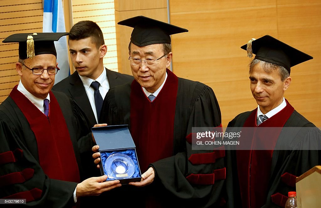 UN general secretary Ban Ki-Moon (C) receives the George S. Wise Medal from the president of the Tel Aviv University Joseph Klafter (L) and the rector Yaron Oz (R) at the Tel Aviv University campus on June 27, 2016. UN chief Ban Ki-moon welcomed a deal between Israel and Turkey to normalise relations after years of acrimony, calling it a 'hopeful signal for the stability of the region.' MAGEN