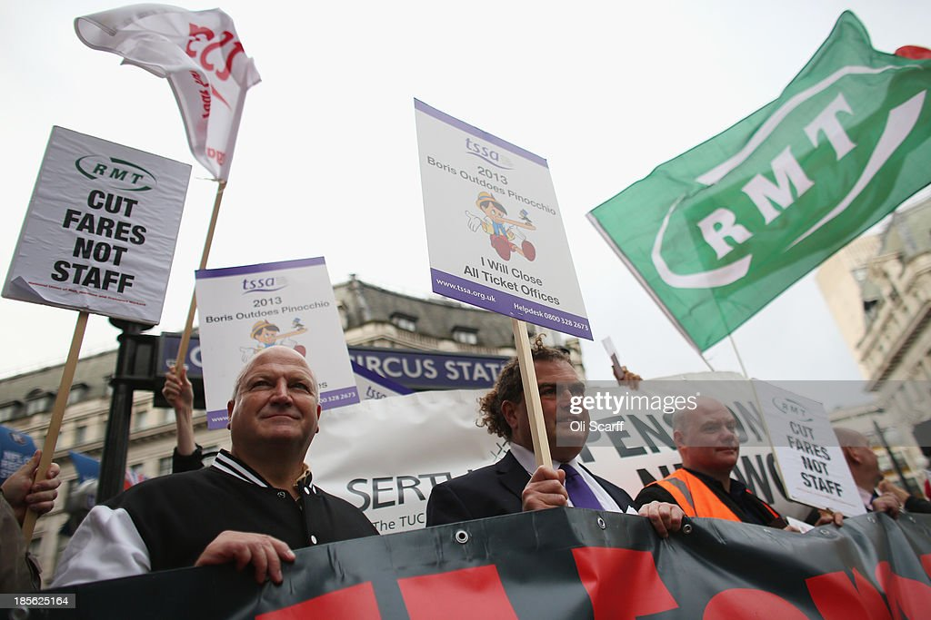 General Secretary <a gi-track='captionPersonalityLinkClicked' href=/galleries/search?phrase=Bob+Crow+-+Trade+Unionist&family=editorial&specificpeople=2222559 ng-click='$event.stopPropagation()'>Bob Crow</a> (L) and TSSA General Secretary Manuel Cortes (C) join campaign groups protesting outside Oxford Circus tube station against plans to reduce staff on transport routes across the Capital on October 23, 2013 in London, England. The proposed changes include the closure of London Underground ticket offices and the removal of guards on London Overground trains.