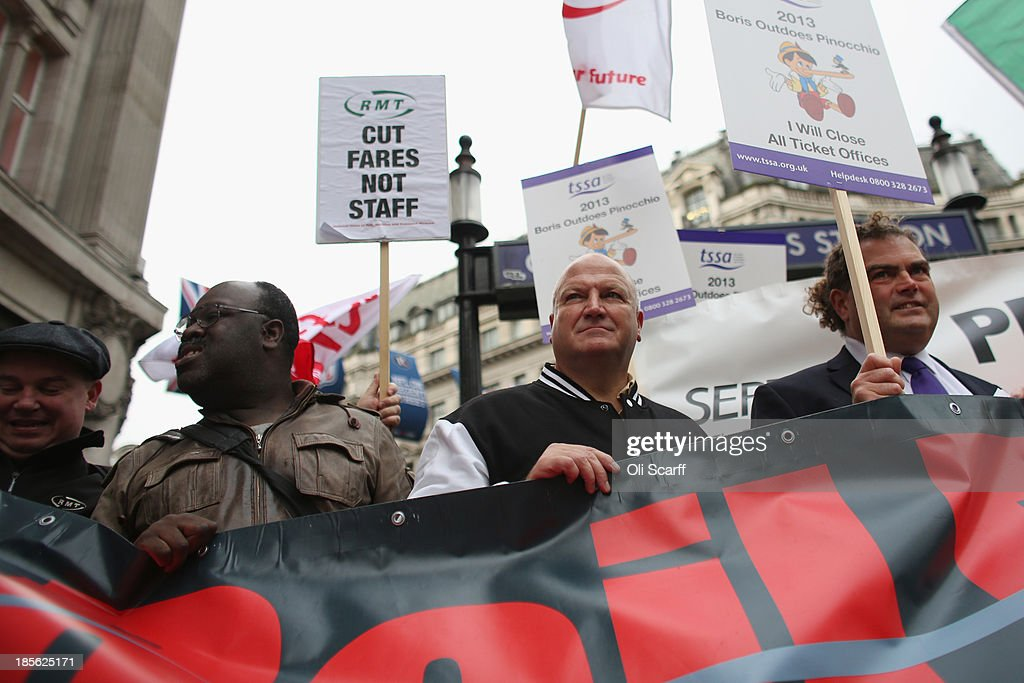 General Secretary <a gi-track='captionPersonalityLinkClicked' href=/galleries/search?phrase=Bob+Crow+-+Trade+Unionist&family=editorial&specificpeople=2222559 ng-click='$event.stopPropagation()'>Bob Crow</a> (C) and TSSA General Secretary Manuel Cortes (R) join campaign groups protesting outside Oxford Circus tube station against plans to reduce staff on transport routes across the Capital on October 23, 2013 in London, England. The proposed changes include the closure of London Underground ticket offices and the removal of guards on London Overground trains.