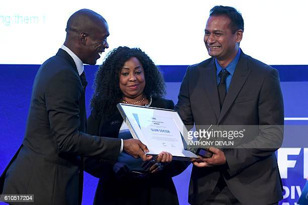 General Secretary Fatma Samoura stands by as Dutch former international footballer Clarence Seedorf presents the FIFA Diversity Award to Abhijeet...