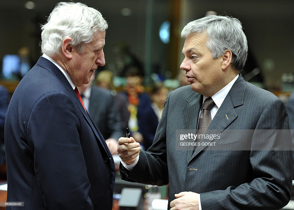 General Secretary for EU External Affairs Pierre Vimont and Belgium Foreign Minister Didier Reynders (R) talk prior an Foreign Affairs Council on March 11, 2013 at the EU Headquarters in Brussels.
