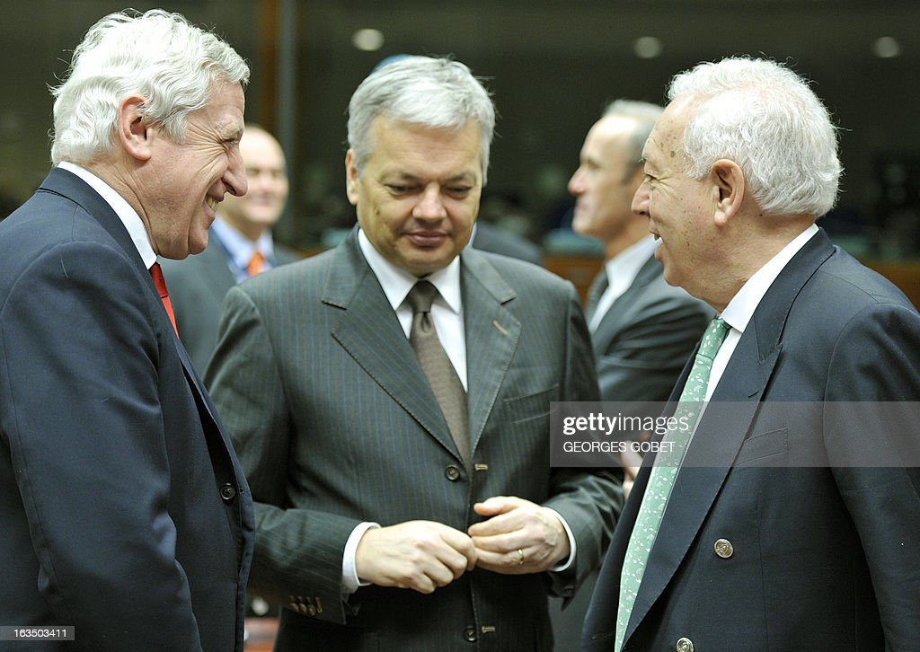 General Secretary for EU external Affairs Pierre Vimont, Belgium's Foreign Minister Didier Reynders and Spanish Foreign Affairs Minister Jose Manuel Garcia Margallo talk prior an Foreign Affairs Council on March 11, 2013 at the EU Headquarters in Brussels. AFP PHOTO GEORGES GOBET