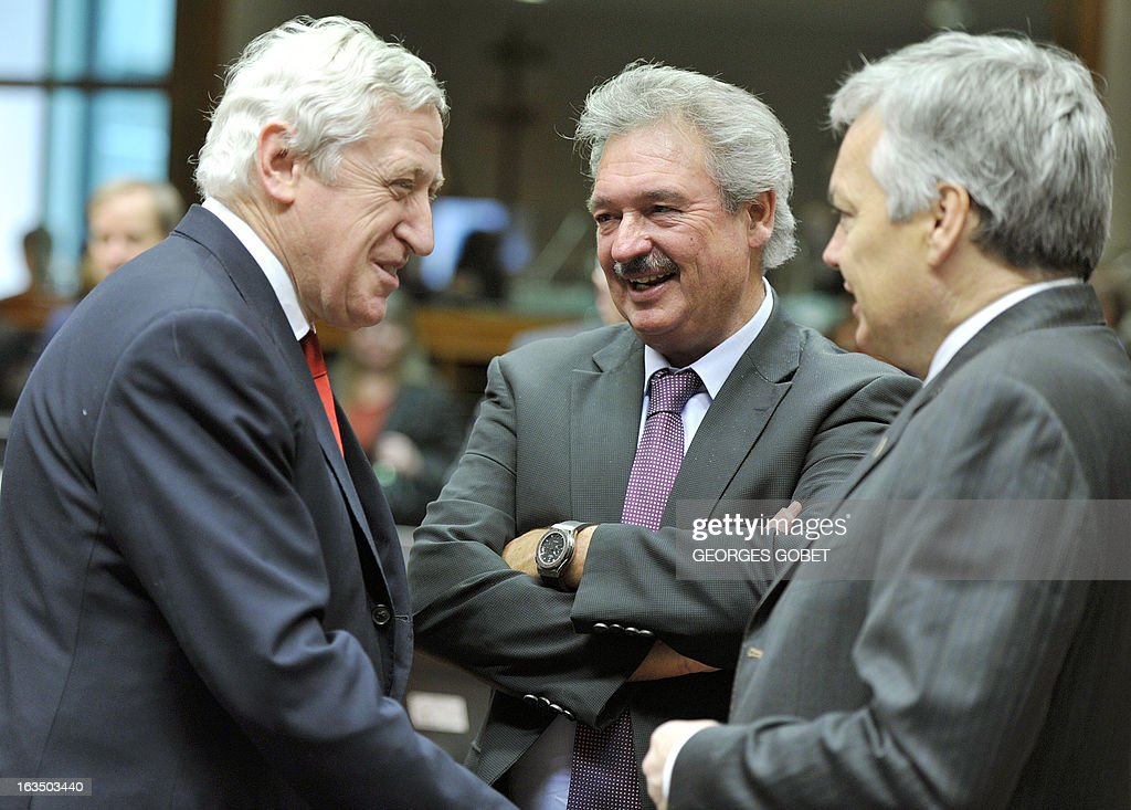 General Secretary for EU external Affairs Pierre Vimont, Luxembourg's Foreign Affairs Minister Jean Asselborn and Belgium's Minister Didier Reynders talk prior an Foreign Affairs Council on March 11, 2013 at the EU Headquarters in Brussels. AFP PHOTO GEORGES GOBET
