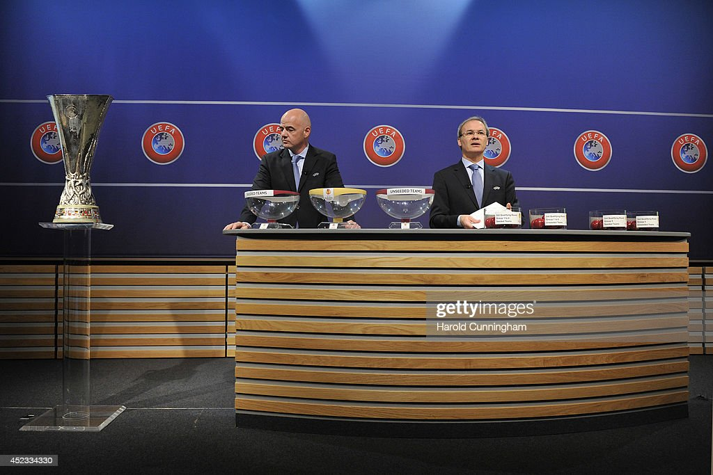 General Secretary Gianni Infantino and UEFA Competition Director Giorgio Marchetti proceeds to the UEFA 2014/15 Europa League third qualifying rounds draw at the UEFA headquarters, The House of European Football, on July 18, 2014 in Nyon, Switzerland.